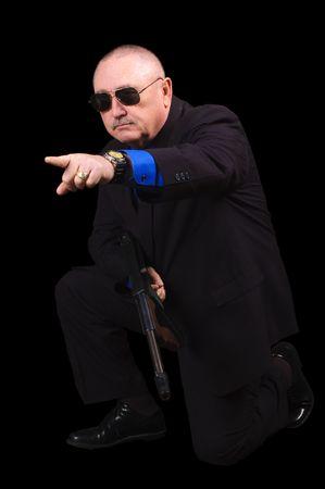 hoodlum: Gangster or Government agent, FBI agent, over a black background