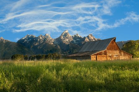 mormon: Old Mormon barn in the Tetons National Park early in the morning Stock Photo