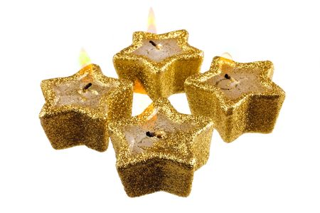 five star: festive five pointed star candles burning on a white background