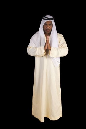 Arabian african man in traditional dress over a black background Stock Photo - 7086956