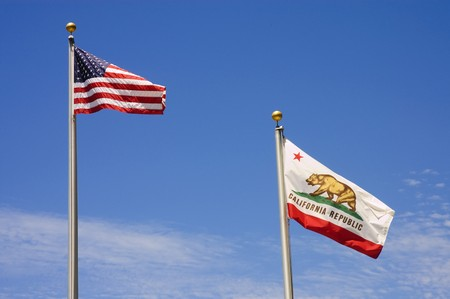 US and California Flags flying against a blue sky Stock Photo - 7400973