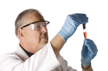 Dramatic lighting of an older doctor looking at a plasma vial for analysis Stock Photo - 7471944
