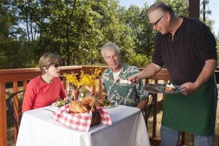 couple enjoying dinner at an outdoor restaurant photo