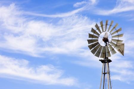 aquifer: wind powered water pump on a farm in California Stock Photo