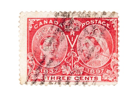 canada stamp: CANADA - CIRCA 1897 : A vintage Canadian postage stamp image of Queen Victoria as a young woman and another of her 60 years later, with a face value of 3 cents, series circa 1897 Stock Photo