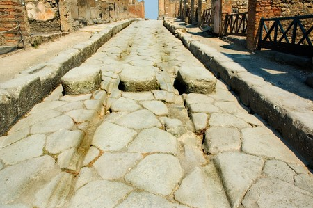 grooves: Roman street in Pompeii with chariot grooves in the stone and stepping stones for pedestrians