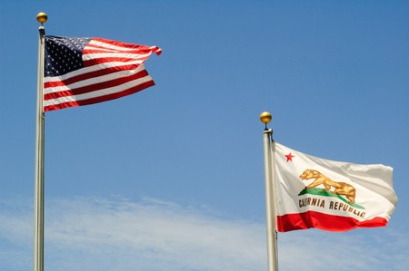 THe US Stars & Stripes, old glory and the California Republic flags waving in a stiff breeze photo
