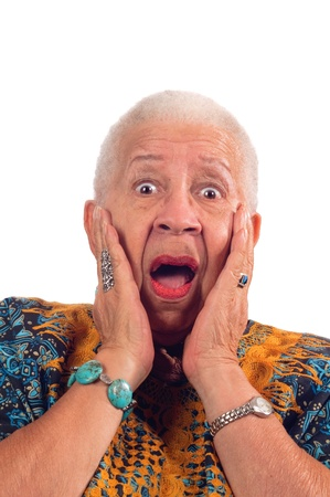 Elderly African American woman with a look of surprise isolated on white photo