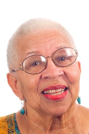 Elderly African American woman with spectacles on and smiling, isolated on white Stock Photo - 8510461