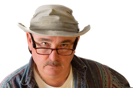 older man with spectacles on and a floppy hat isolated on white