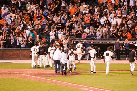 giants: SAN FRANCISCO, CA - SEPTEMBER 28: San frnacisco Giants celebrating after winning a game against the Arizona Diamondbacks putting them in the lead for the Western Division, September 28, 2010