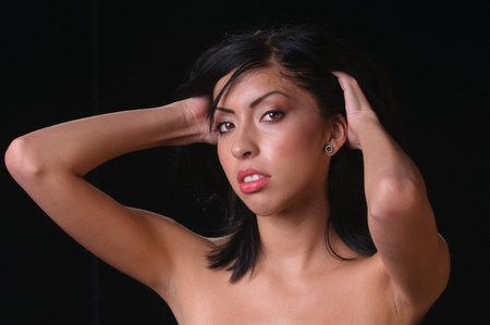 black backgound: hispanic woman with beautiful eyes over a black backgound