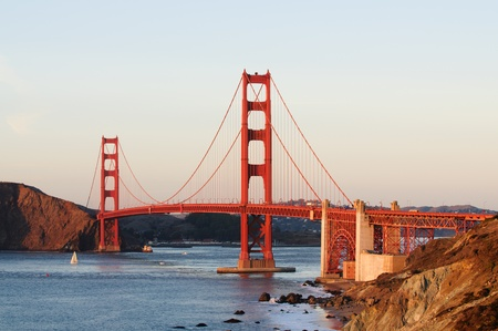 Golden Gate Bridge from Bakers Beach area in San Francisco at sunset photo
