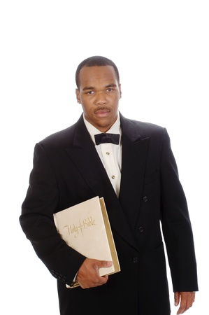 African American preacher holding a bible, isolated over white Stock Photo