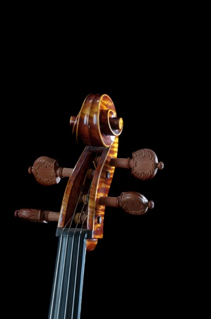 Neck of a beautiful Cello against a black background Stock Photo
