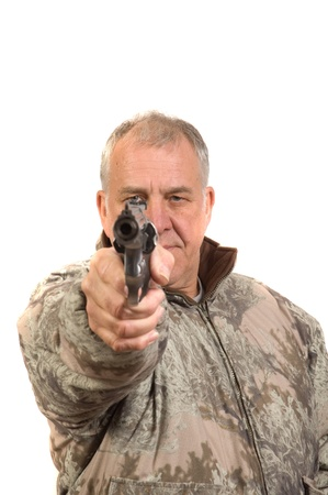 Senior hunter in sage camo with revolver pointed at viewer isolated on white