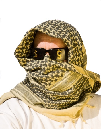 keffiyeh: Arab man with sunglasses on that have dollar signs  on them representing petro dollars, power, economic power, strength and control Stock Photo