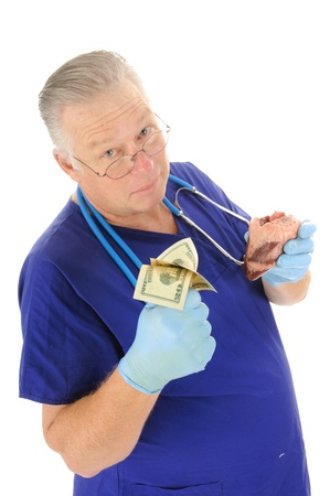 doctor money: Doctor holding fist full of money repesenting the escalating costs of medical atention, and or body parts for sale Stock Photo