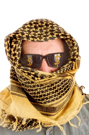Arab man with sunglasses on that have dollar signs  on them representing petro dollars, power, economic power, strength and control photo