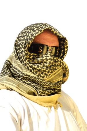 Arab man with sunglasses which have dollar signs painted ontot hem signifying petro dollars and tha increasing price of gasoline photo