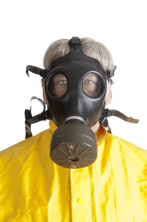 man in gas mask and hazmat suit photo
