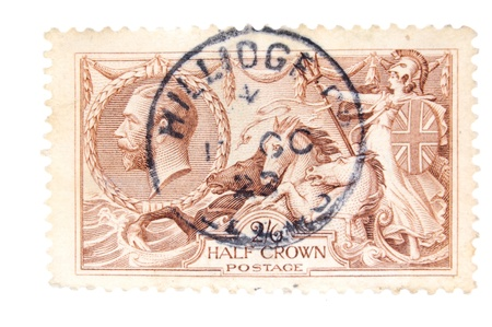 britannia: Canada - Circa 1930 : A vintage English postage stamp image of Britannia on chariot with horses and inset of King George value Half Crown, series circa 1929
