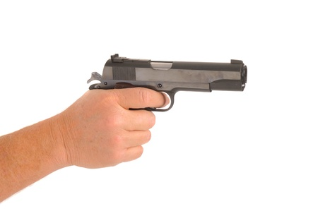 cocked: hand holding semi-automatic pistol cocked ready to fire, isolated on white