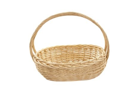 Woven Basket For Easter Or Fruit On A White Background Photo