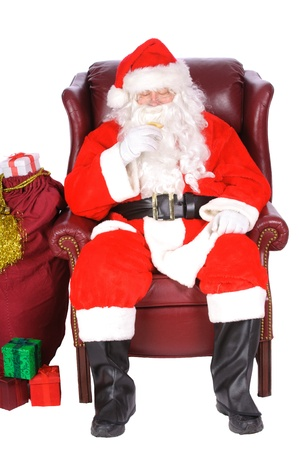 st  nick: Santa enjoying a rest after a nights work, with a small libation Stock Photo