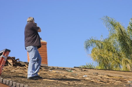photographer documenting damage to a roof