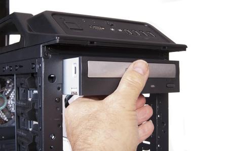 technician installing a DVD drive into a desktiop computer Stock Photo - 13735738
