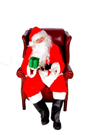 Humorus closeup of Santa Claus  that jolly old elf that  lives at the North Pole  reading and writing in the book of good children Stock Photo