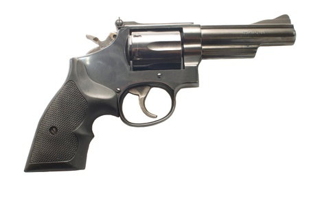 cocked: Handgun isolated on a white background