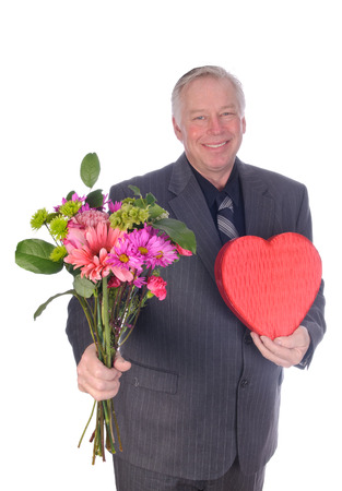 Sweets for my sweet, man in business suit offering chocolates and flowers to his sweetheart