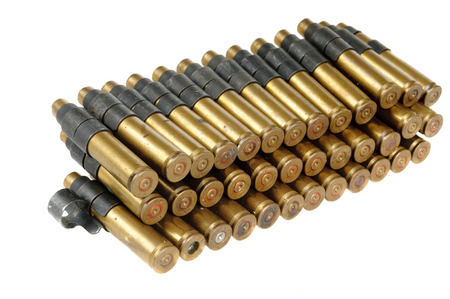 Machine gun ammunition belt isolated on white