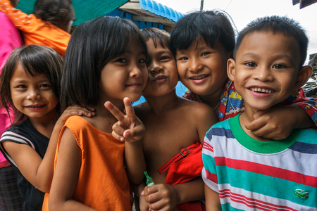 SIHANOUKVILLE, CAMBODIA - 7/20/2015: A group of children play in the streets of their fishing village. Фото со стока - 85597833