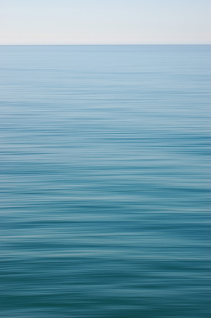 Slow shutter view of infinite blue ocean