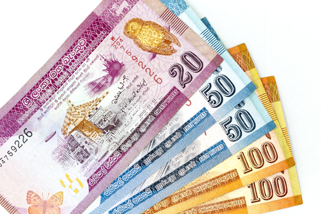 Currency banknotes spread across frame sri lankan rupee in various denomination Фото со стока