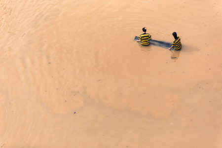Flood caused by tropical storm near river town in Malaysia