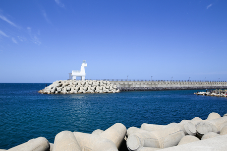 Iho Lighthouse at Iho Tewoo beach in the North of Jeju South Korea Asia Foto de archivo