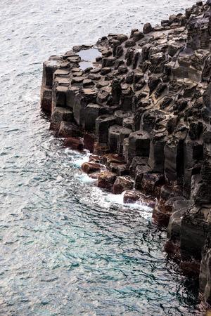 Volcanic pillar cliff near sea shore seaside in Jusangjeolli Seogwipo Jeju South Korea Stock Photo