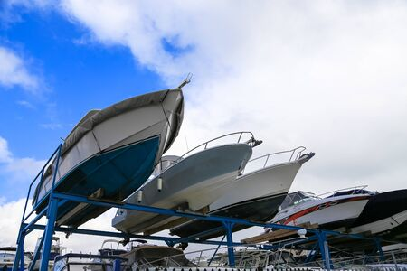 Boat yatch lifted to shelf for sale appreciation viewing with cloudy sky background