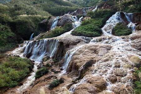 Huangjin Waterfall near YinYang Sea popular tourist destination in Taipei Taiwan Stock Photo