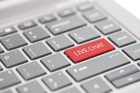 Automated smart chat bot messenger assistant to business support calls concept shown on close up enter key on notebook keyboard Foto de archivo