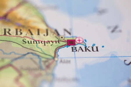Shallow depth of field focus on geographical map location of Baku city Azerbaijan Europe continent on atlas