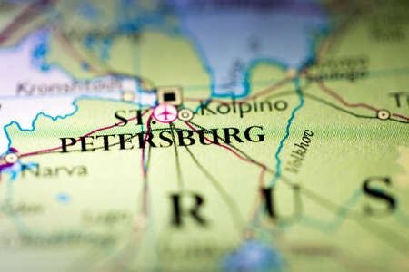 Shallow depth of field focus on geographical map location of Saint Petersburg city Russia Europe continent on atlas 版權商用圖片