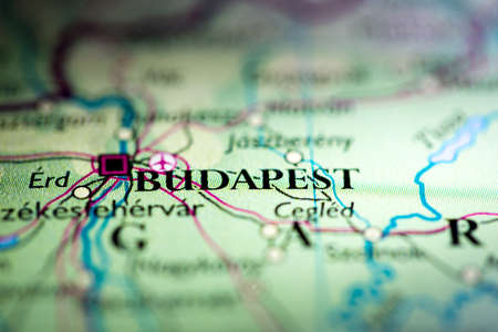 Shallow depth of field focus on geographical map location of Budapest city Hungary Europe continent on atlas