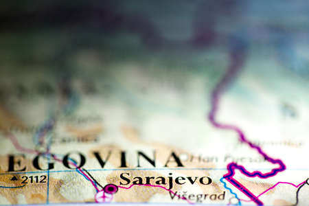 Shallow depth of field focus on geographical map location of Sarajevo city Bosnia and Herzegovina Europe continent on atlas 版權商用圖片