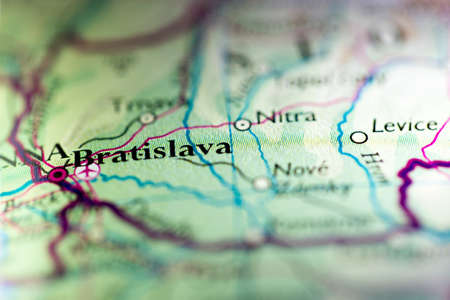 Shallow depth of field focus on geographical map location of Bratislava city Slovakia Europe continent on atlas