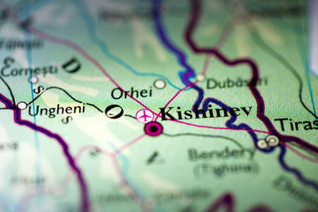 Shallow depth of field focus on geographical map location of Kishinev city Moldova Europe continent on atlas
